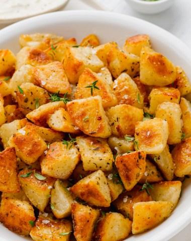 a plate full of crispy potatoes