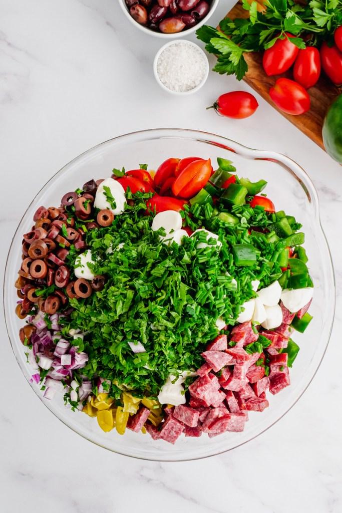 Making antipasto pasta salad