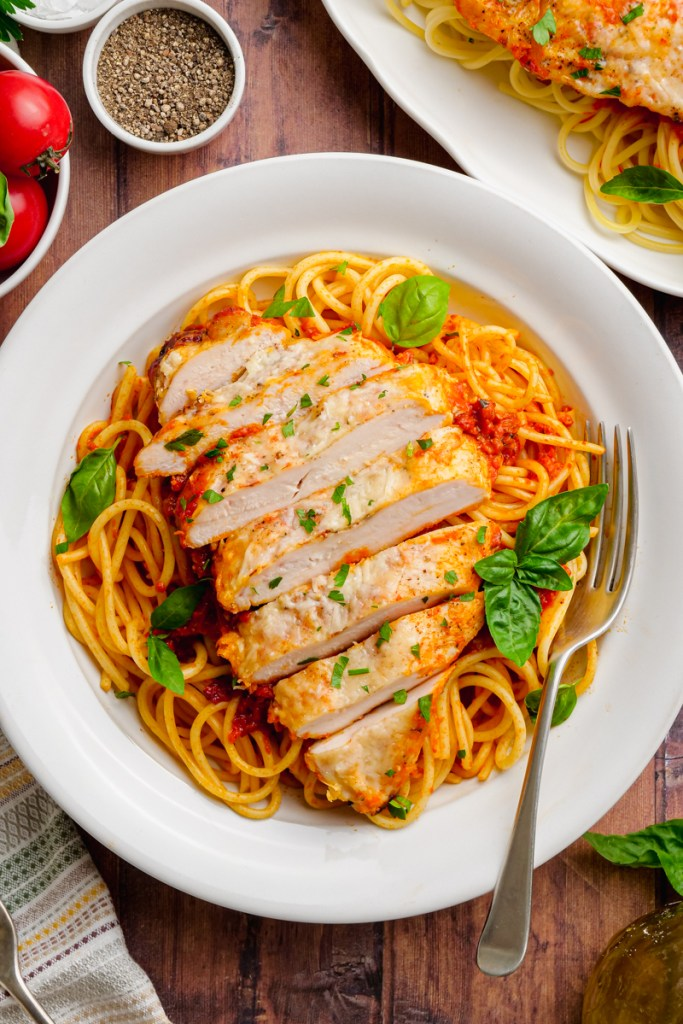 chicken pomodoro on a white plate with fork