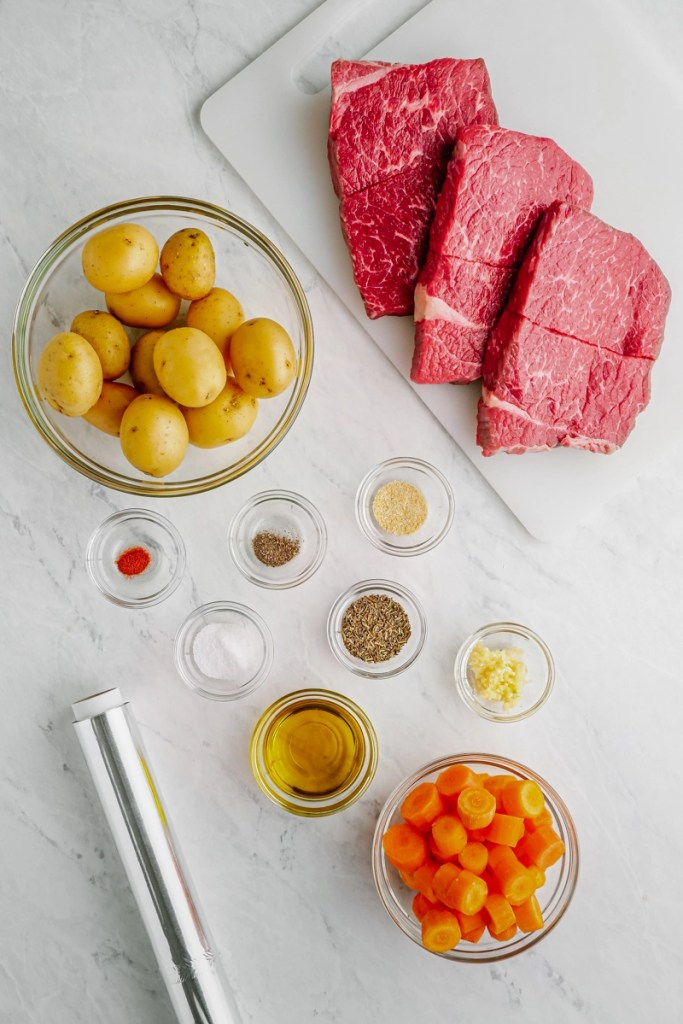 steak and potato ingredients on cutting board