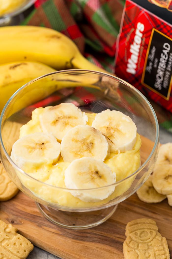 Bananas layered over top of eggnog banana pudding.