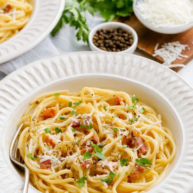 Spaghetti carbonara is a delicious spaghetti with bacon, eggs, and more.
