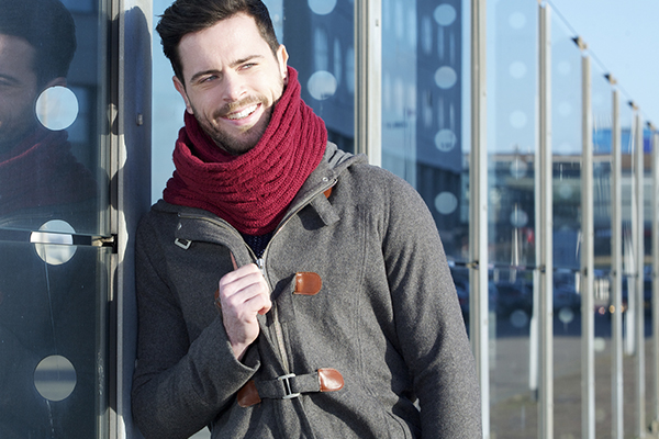 Man wearing jacket and scarf