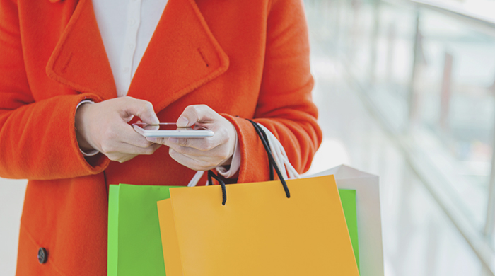 Female Shopper Texting