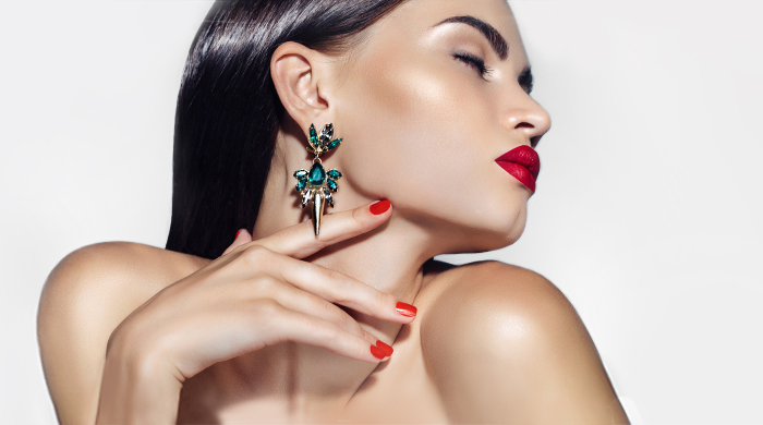 Woman Wearing Green Earrings