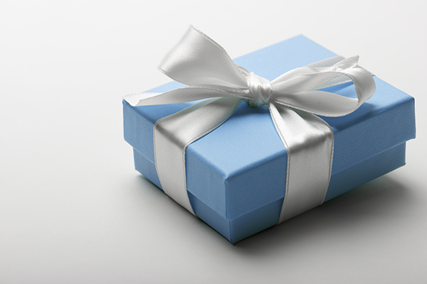Blue box wrapped with white ribbon gift present
