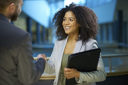 Young woman shaking hands after an interview
