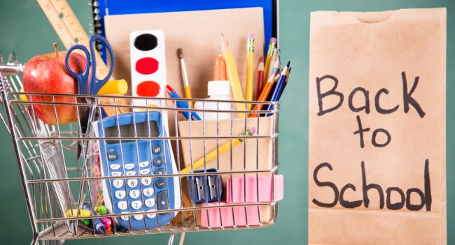 Shopping cart filled with back to school supplies.
