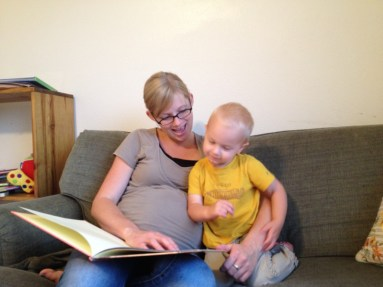 It's story time! Ben Elliot enjoys the last days that he has Mommy and Daddy all for himself... :)
