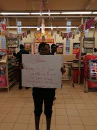 A Nigerian Lady Protesting inside Shopright Lagos for the killings of Nigerians in South Africa (watch video)