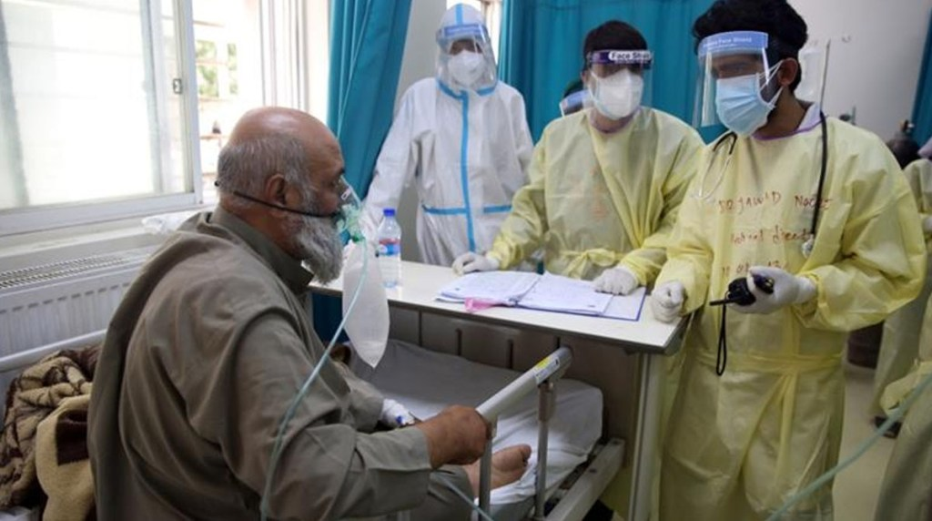 Coronavirus is overwhelming Afghanistan healthcare system, pushing one-third of the population into poverty