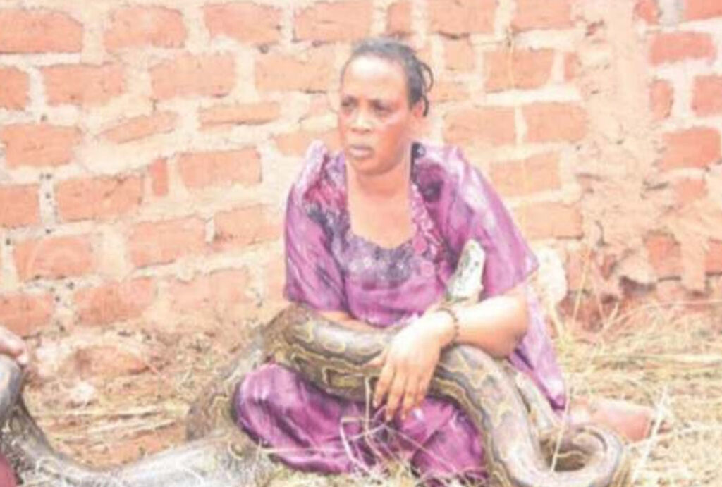 A-woman-was-caught-at-her-friends-house-breastfeeding-a-giant-snake
