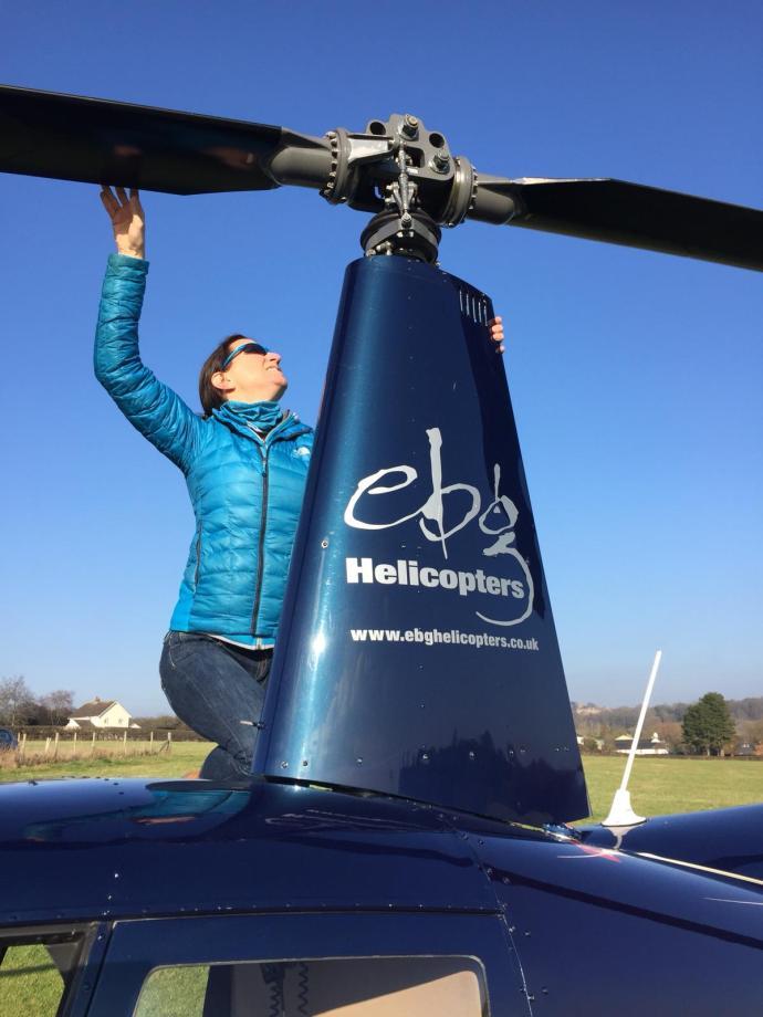 Pre flight checks on a R44 by Captain Anne-Marie.