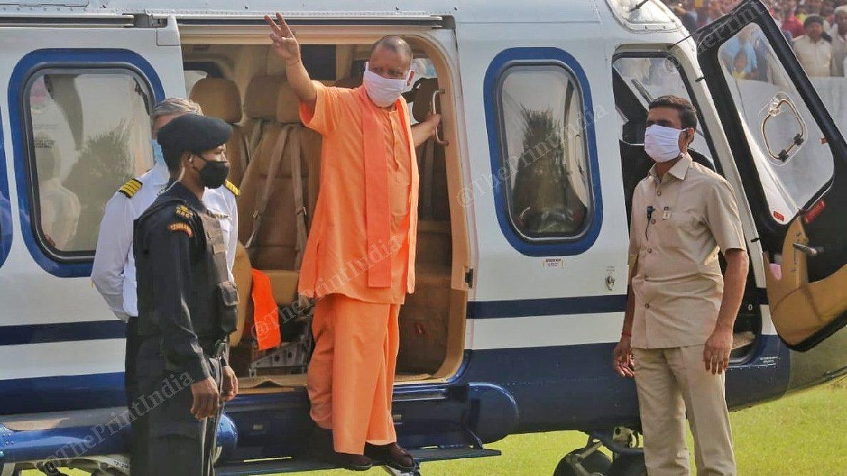 Chief Minister of Uttar Pradesh Yogi Adityanath waving crowd before addressing the public