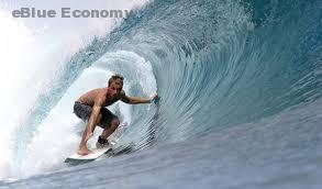 eBlue_economy_استرالى_راكب_امواج