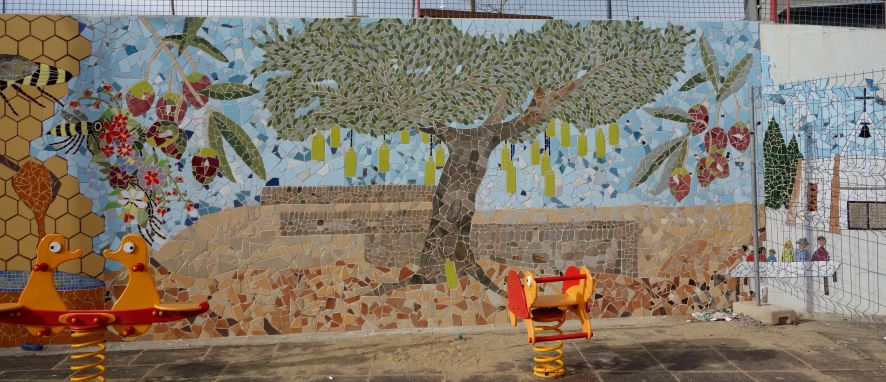The olive tree laden with bottles of oil at Firabril