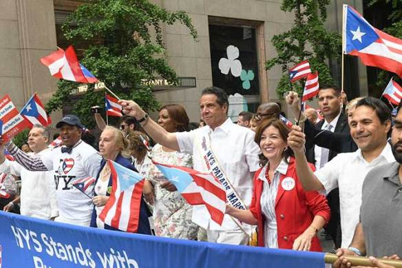 8d43d38e5a Governor Andrew Cuomo at Sunday's Puerto Rican Day Parade, where he  announced that six sites within Battery Park City are being considered for  a memorial to ...