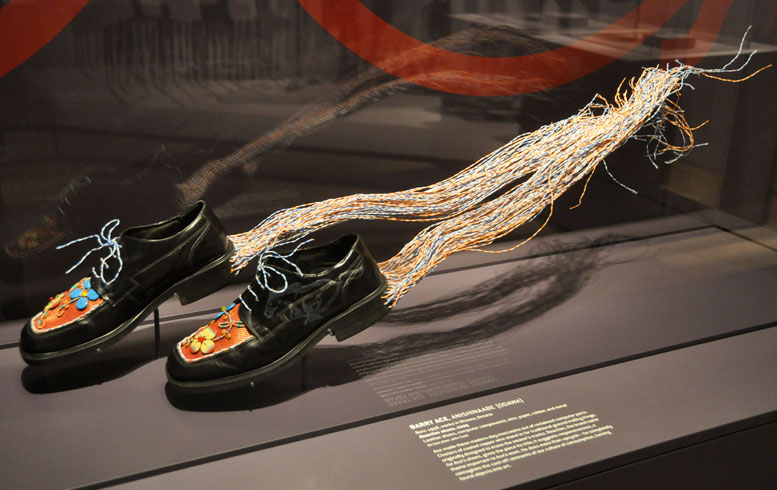 Reaction shoes, 2005  Leather shoes, computer components, wire, paper,  rubber and metal  Barry Ace, Anishinaabe (Odawa)