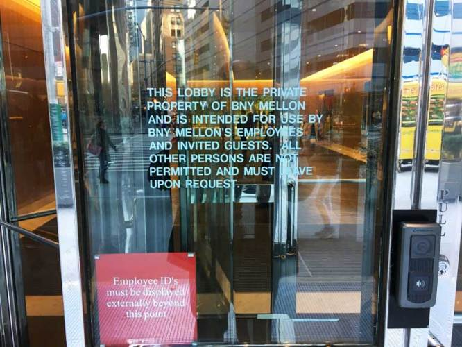 """A sign that adorns every entrance to 101 Barclay warns members of the public that they are not welcome. This sign remains in place despite a new law that specifically requires compliance with promises of amenities in """"privately owned public spaces."""""""