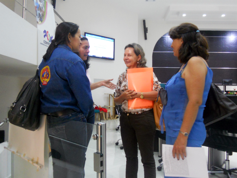 Yolanda Becerra, OFP director (middle of photo),and Gloria Amparo Suarez (right) at the 2012 Women's Tribunals in Colombia. (Photo: Kairos Canada)