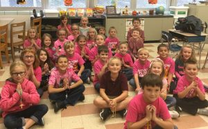 Students celebrate Blessed Mother's appearance at Fatima through prayer