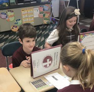 Fourth-graders have some fun practicing new spelling words