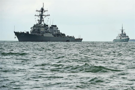 USS John S. McCain (L) is seen at sea off Singapore's Changi Naval Base, on Aug. 21, 2017. Ten sailors were missing and five others injured after the guided-missile destroyer USS John S. McCain collided with a merchant vessel in waters east of the Straits of Malacca and Singapore early on Monday, the U.S. navy said in a statement. (Xinhua/Then Chih Wey)