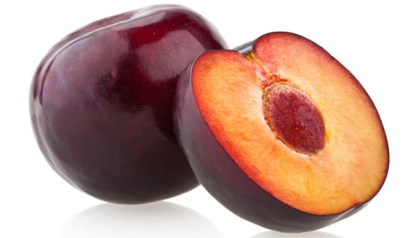 one whole organic plum and one cut