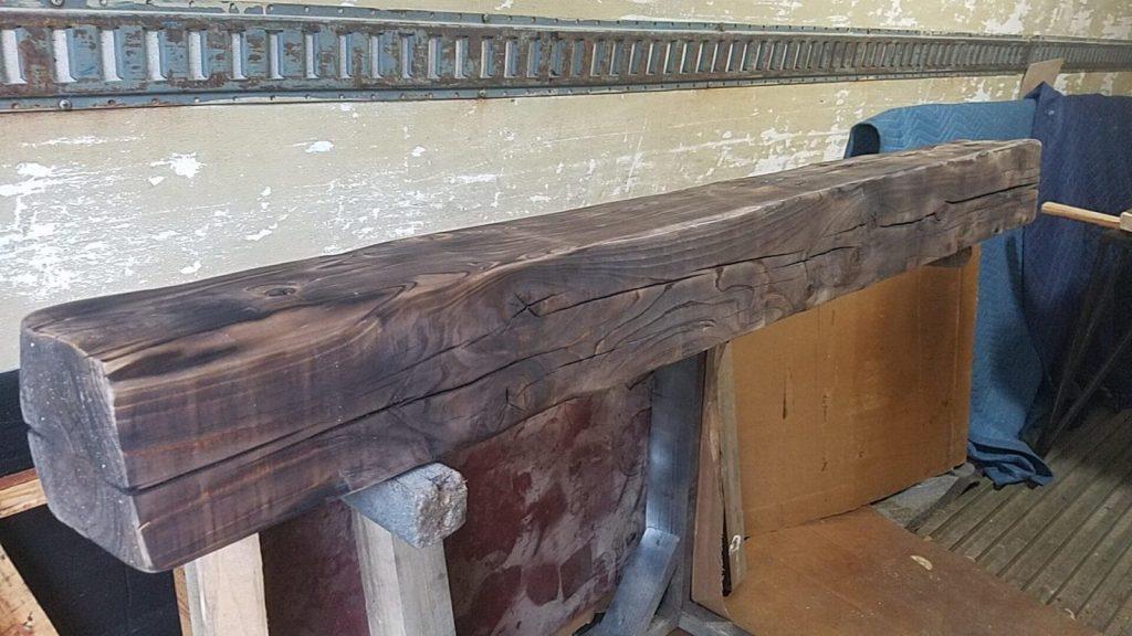 Rustic reclaimed beam mantle