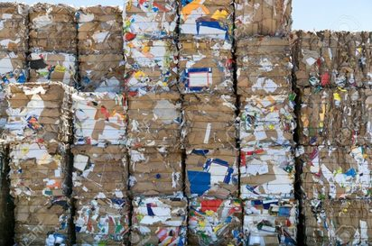 -big-stack-of-paper-bales-for-recycling-featured
