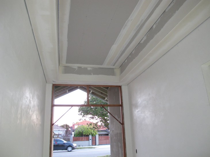 Shadowline ceiling in the entry
