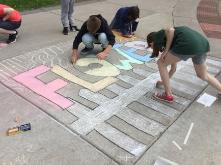 Lincoln Park Middle School students create chalk art.