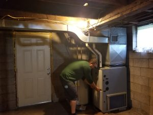 Action shot of furnace upgrades