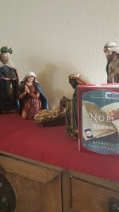 Book Noel Diary with nativity as backdrop