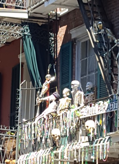 Group of skeletons on balcony.