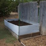 Garden bed with raised sides made from rec