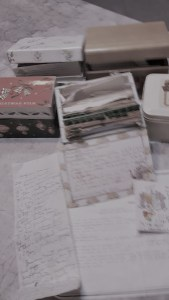 Multiple recipe boxes on a kitchen counter