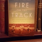 Book Cover of Fire on the Track with old bookcase as background