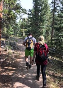 two people hiking on a trail