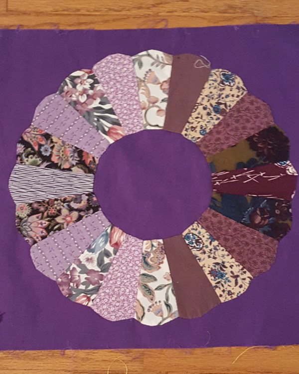 Quilt block Dresden Plate on purple background