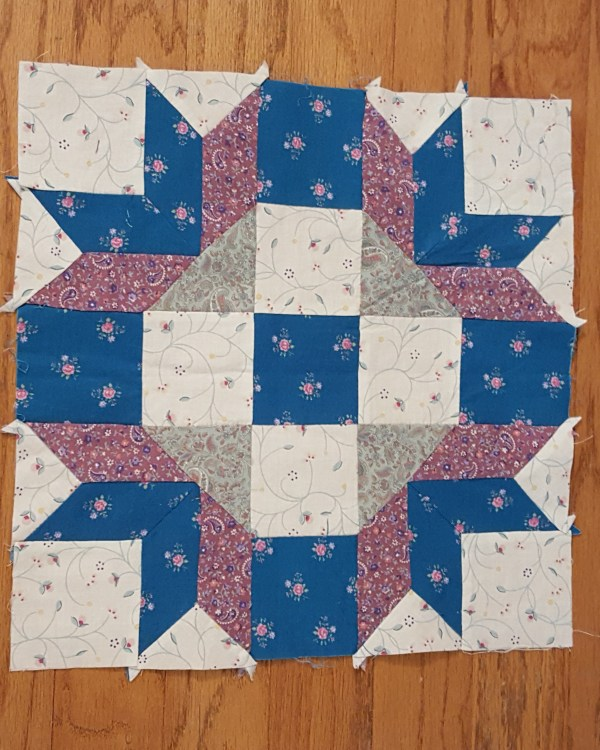 Quilt Block teals and lavender on white background