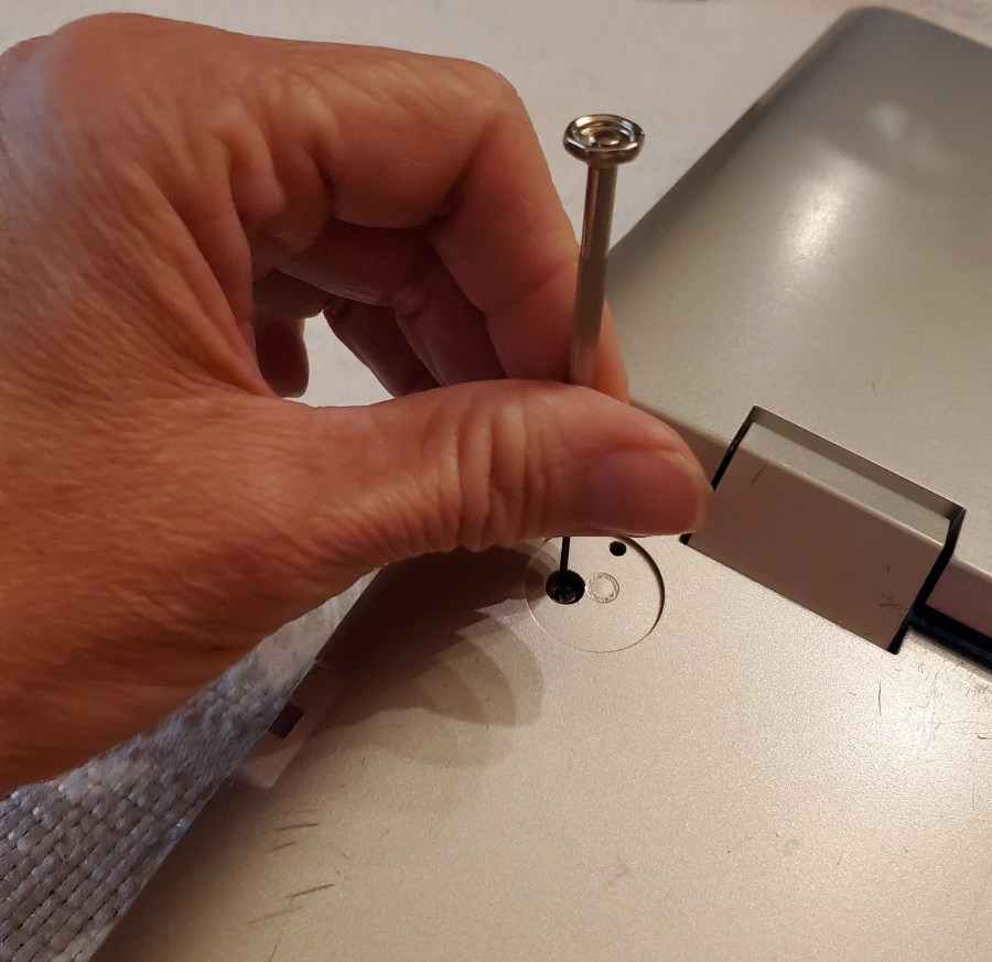 Replacing exterior screws with small screwdriver