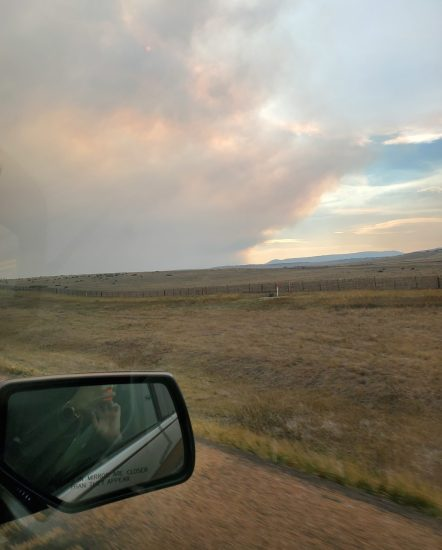 View of fire smoke from passenger seat of car