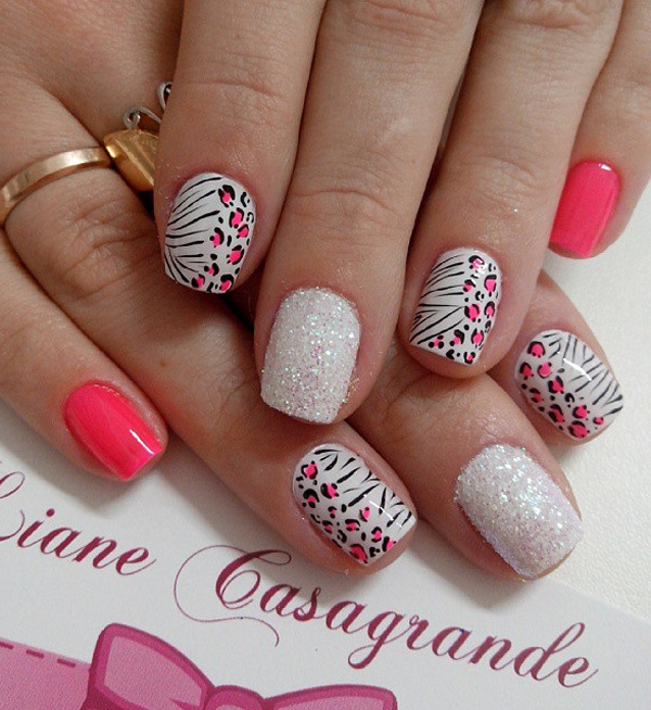 A pretty pink and white leopard nail art design with glitter. - 60 Stylish Leopard And Cheetah Nail Designs That You Will Love