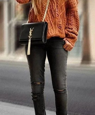 women's orange off-shoulder sweater, distressed gray-washed skinny jeans and pair of brown suede boots outfit