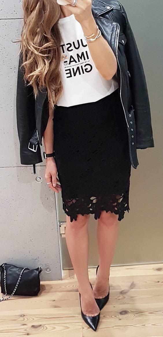 women's black leather zip-up jacket and black mini skirt