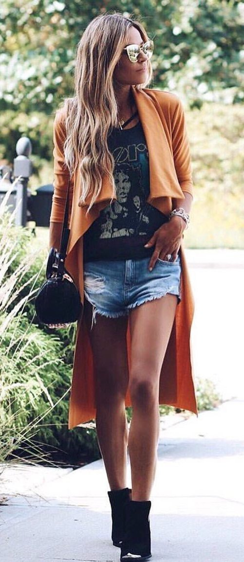 women's brown long sleeve cardigan, black top and blue shorts