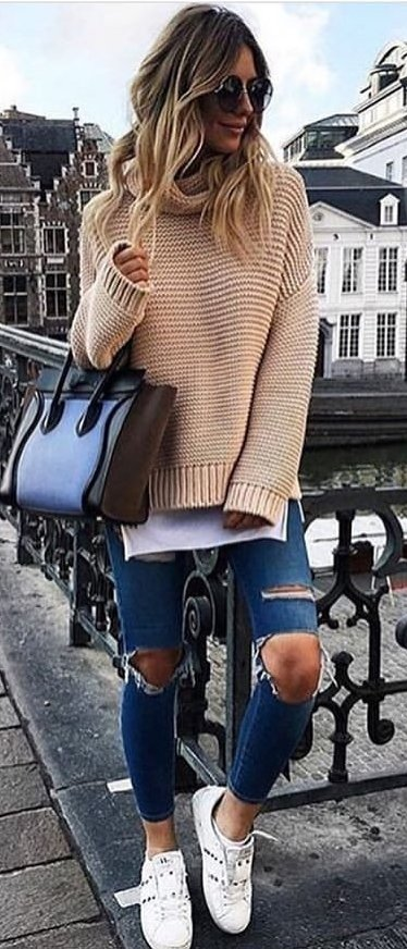 women's brown turtleneck sweater and distressed blue jeans