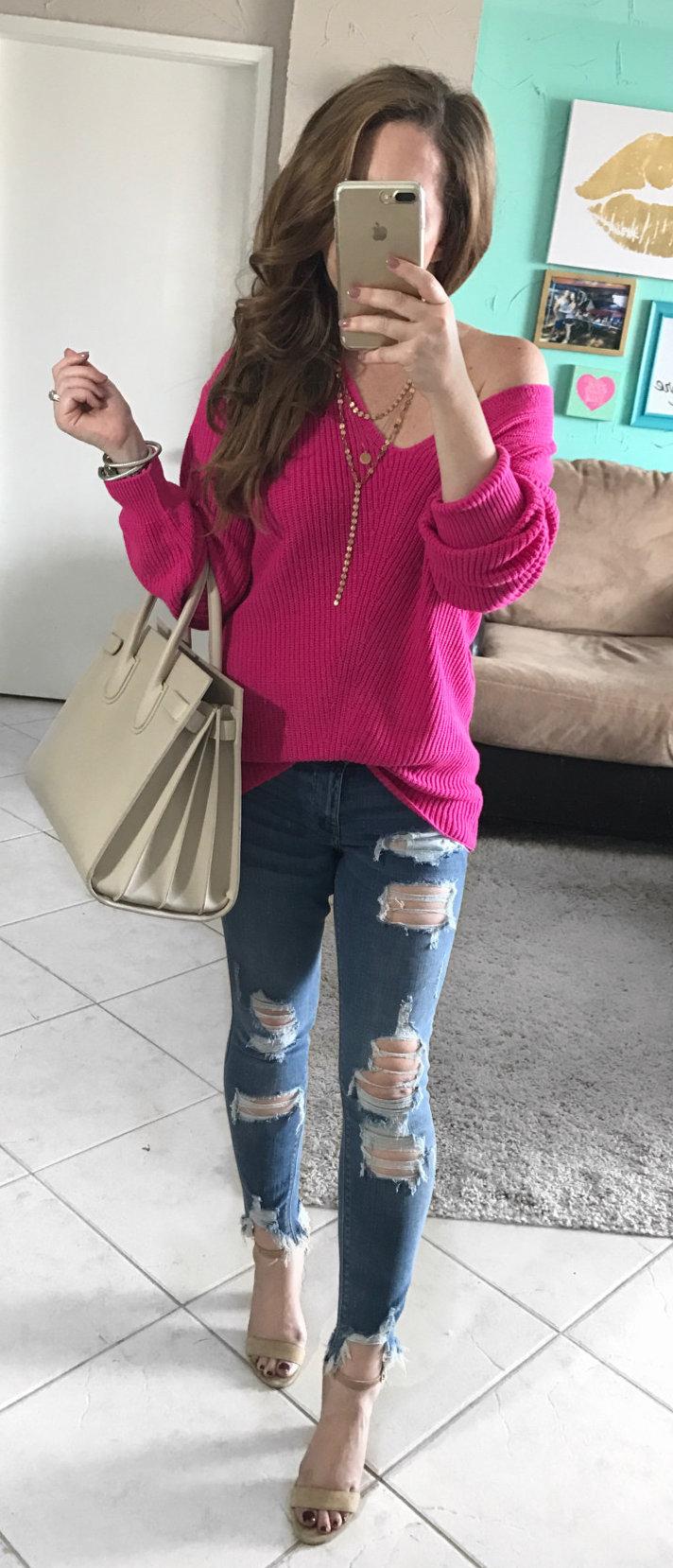 women's pink off-shoulder long-sleeve shirt with blue distressed denim jeans