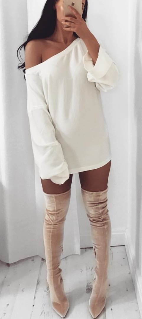 women's white one shoulder long-sleeved top